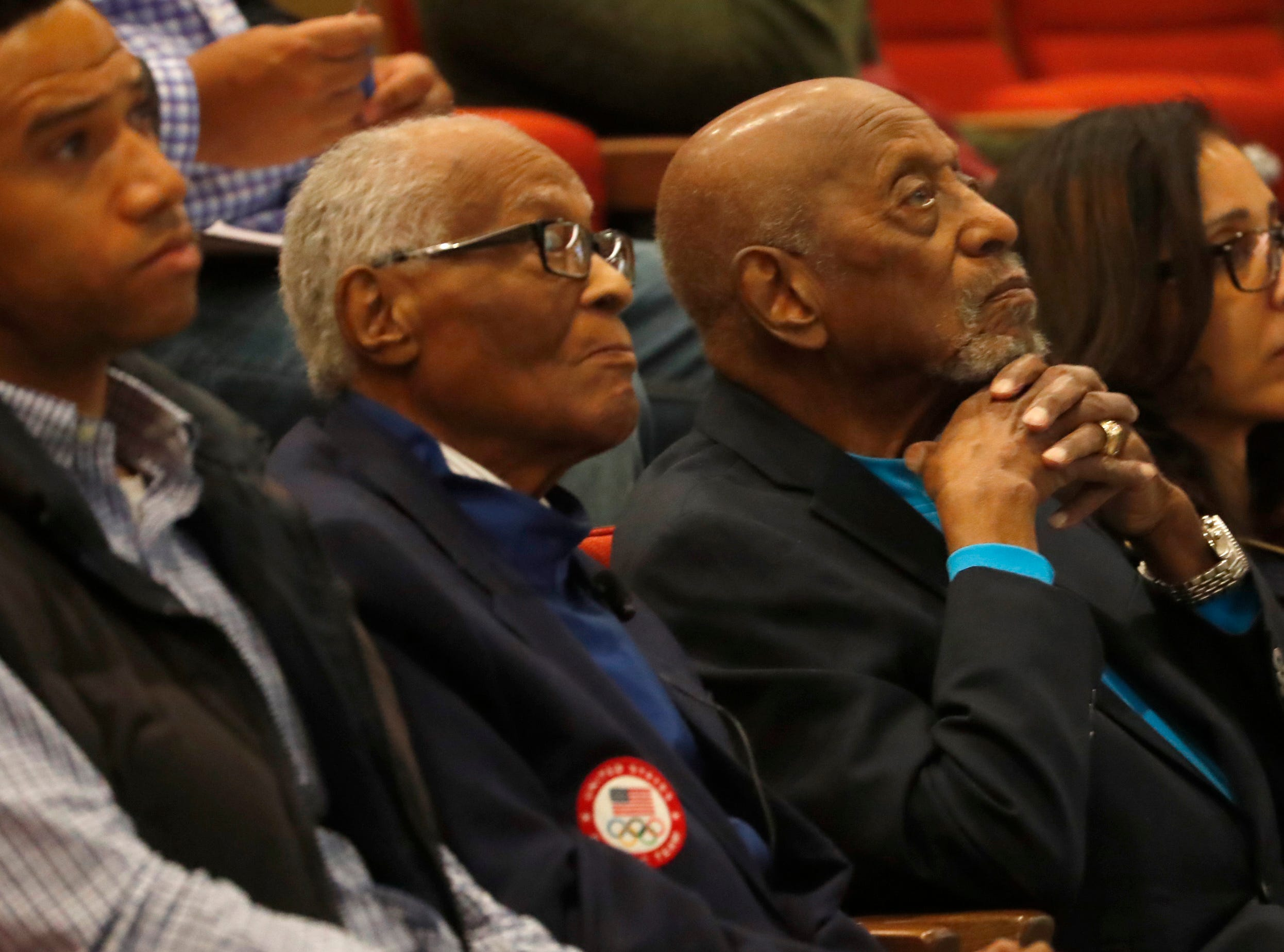 Herbert Douglas (center), the oldest living black Olympic medalist, Harrison Dillard (center-right) watch a documentary screening of The Renaissance Period of the African American at Beus Center for Law and Society in Phoenix, Ariz. on February 11, 2019.