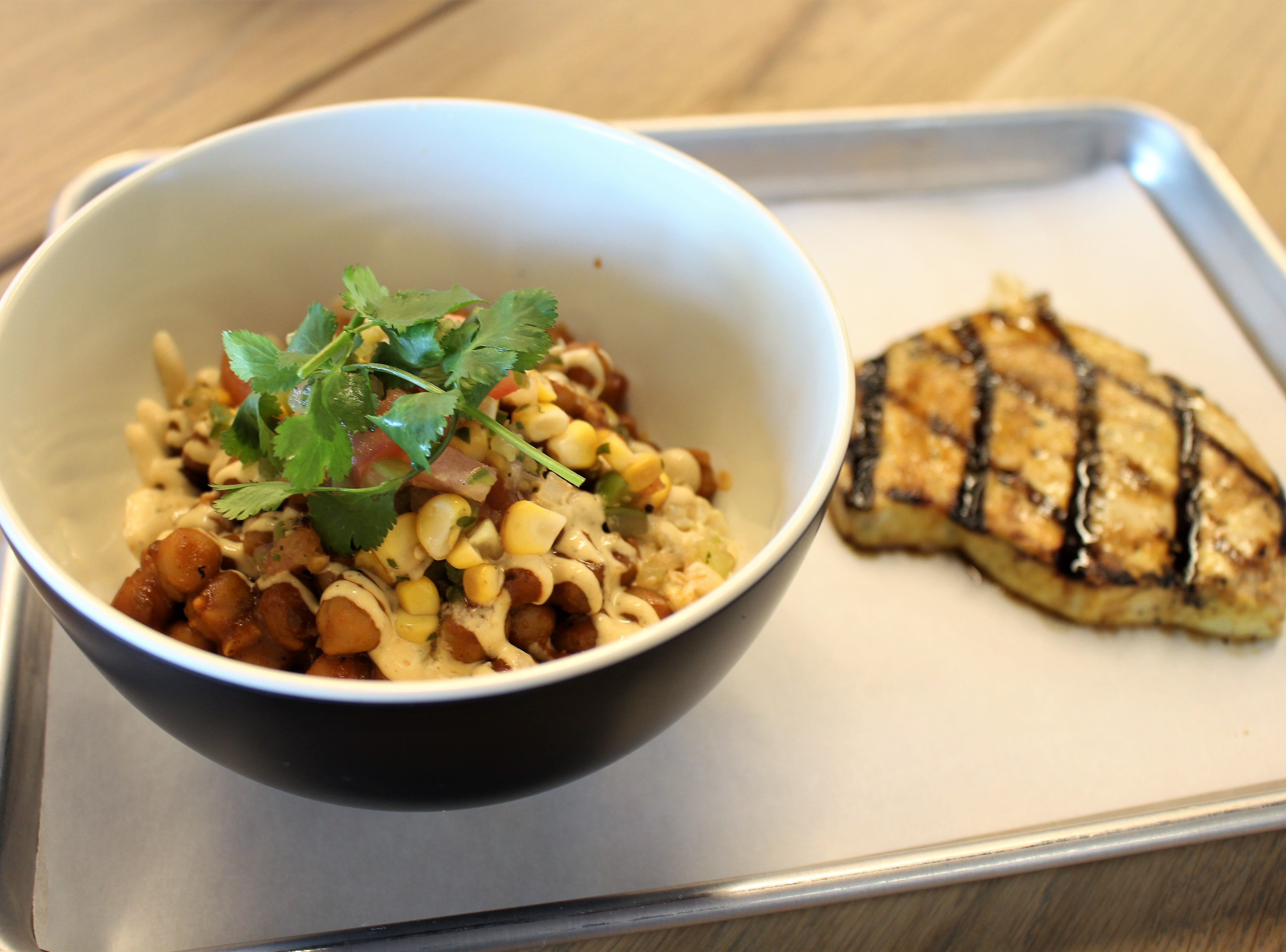 Chula Seafood at Uptown Plaza in Phoenix serves as expanded menu including a Brown Rice Bowl with a side of fresh-caught swordfish.