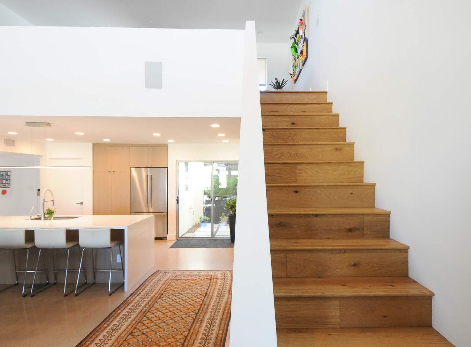 The new staircase, wood instead of metal, leads to a loft on the second level.
