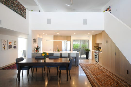 The living, dining and kitchen area flow into each other with a loft above.