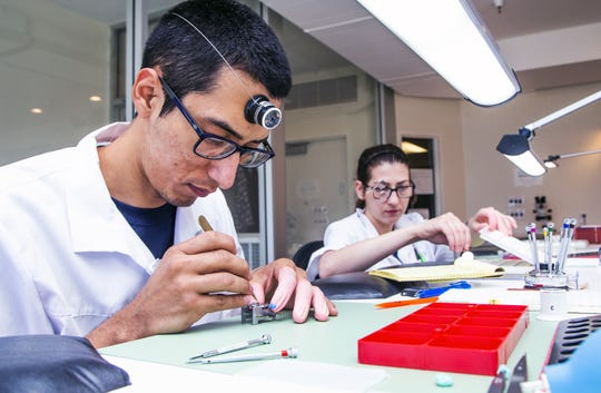 Armando Munoz (left) and Kaitlyn Gagliano assemble watch movements at the FTS USA facility in Fountain Hills on Feb. 8, 2019.