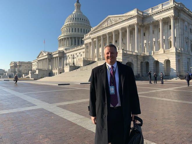 Arizona Republic reporter Ronald J. Hansen poses in Washington, D.C., in February 2019.