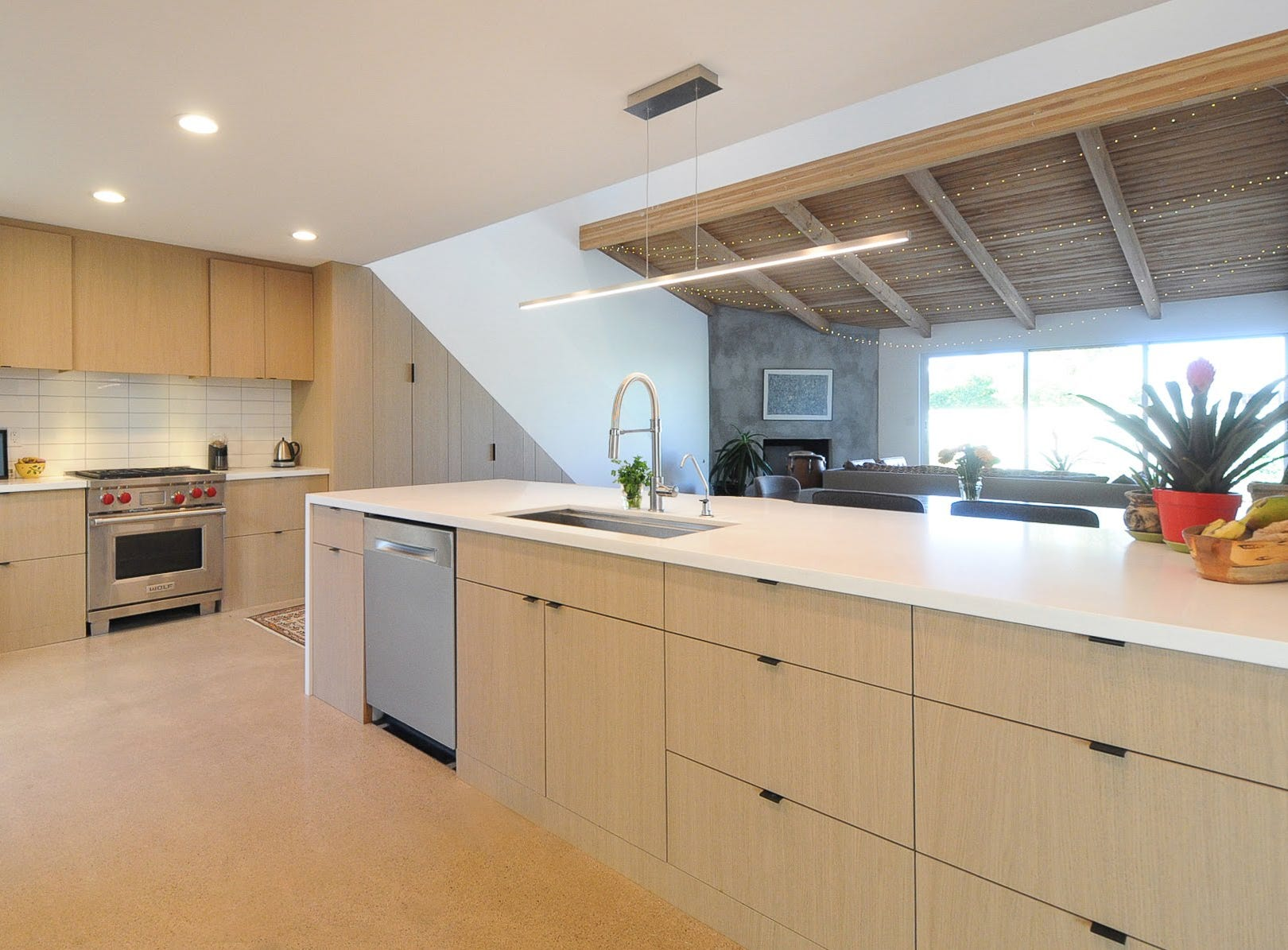 An open kitchen feels even more so thanks to elevated ceilings in the adjacent family room.