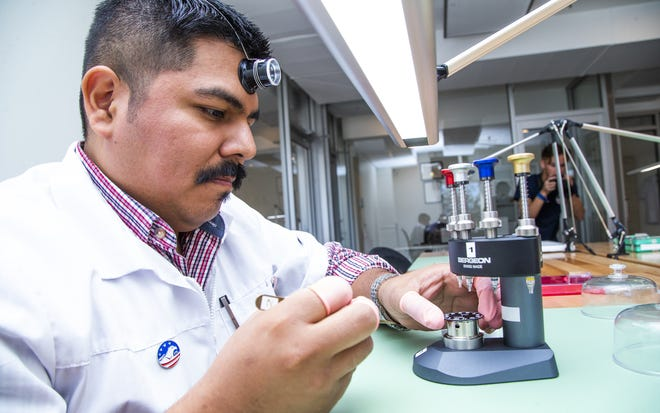Johnny Bravo assembles a watch movement at the FTS USA facility in Fountain Hills on Feb. 8, 2019.
