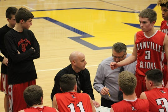Head coach Jason Coletti, center, talks to his Annville-Cleona boys basketball team during a timeout of a recent game against Middletown. A-C won its last four games to earn a district playoff berth for the first time since thec 2012-13 season.