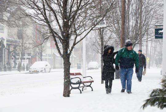 Josie and Leo Bourn walk down Mill Street in Rhinebeck on February 12, 2019.