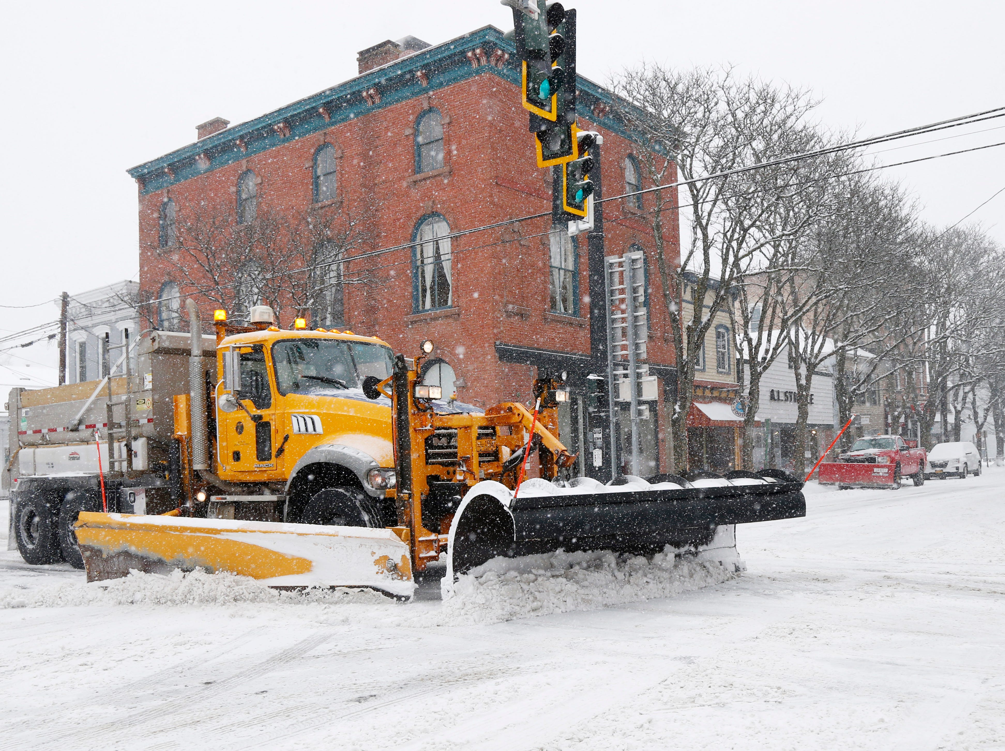 A NYSDOT clears snow on Mill Street in Rhinebeck on February 12, 2019.