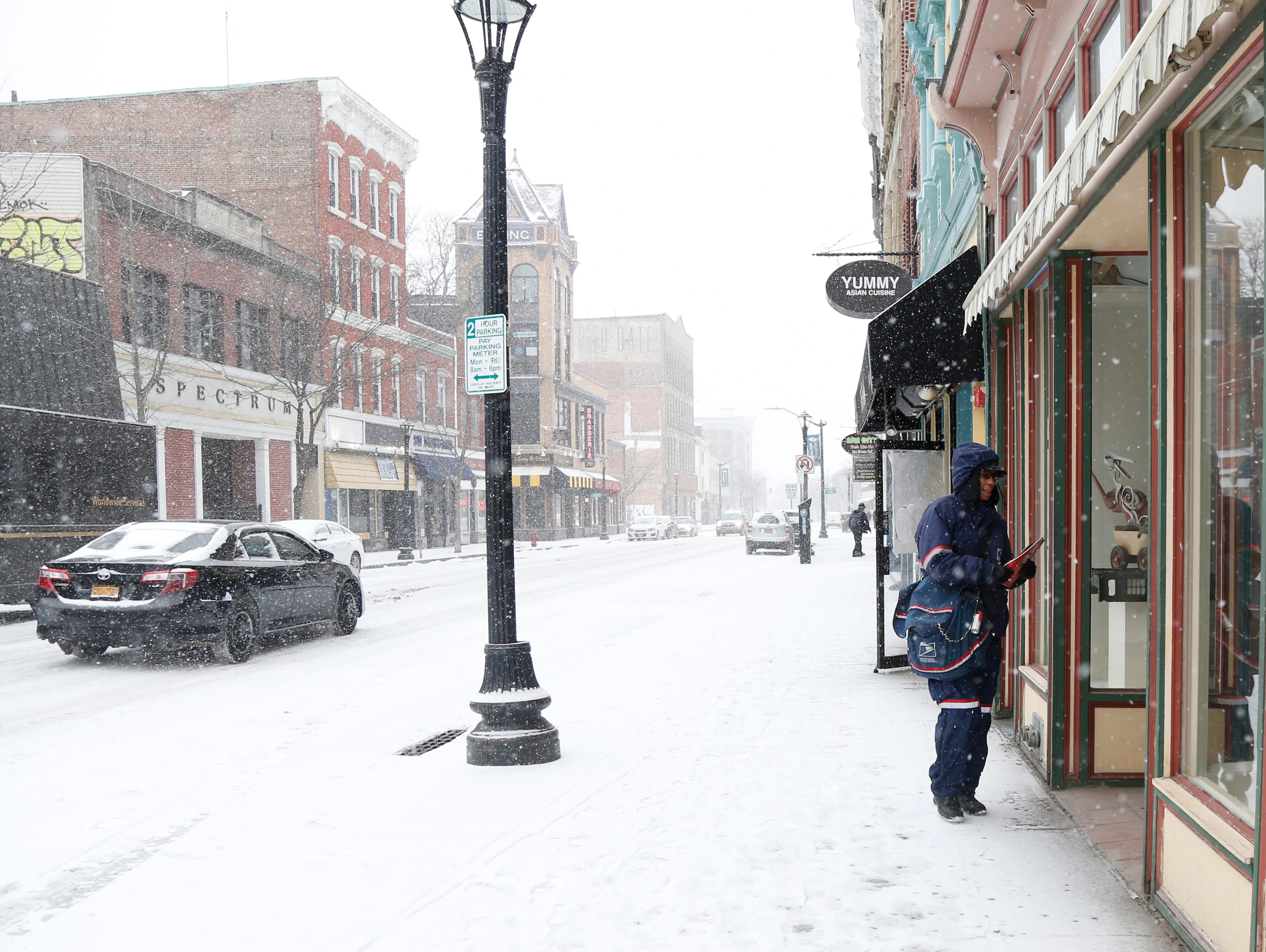 USPS Letter Carrier Lisa Andino delivers mail on Main Street in the City of Poughkeepsie on February 12, 2019.