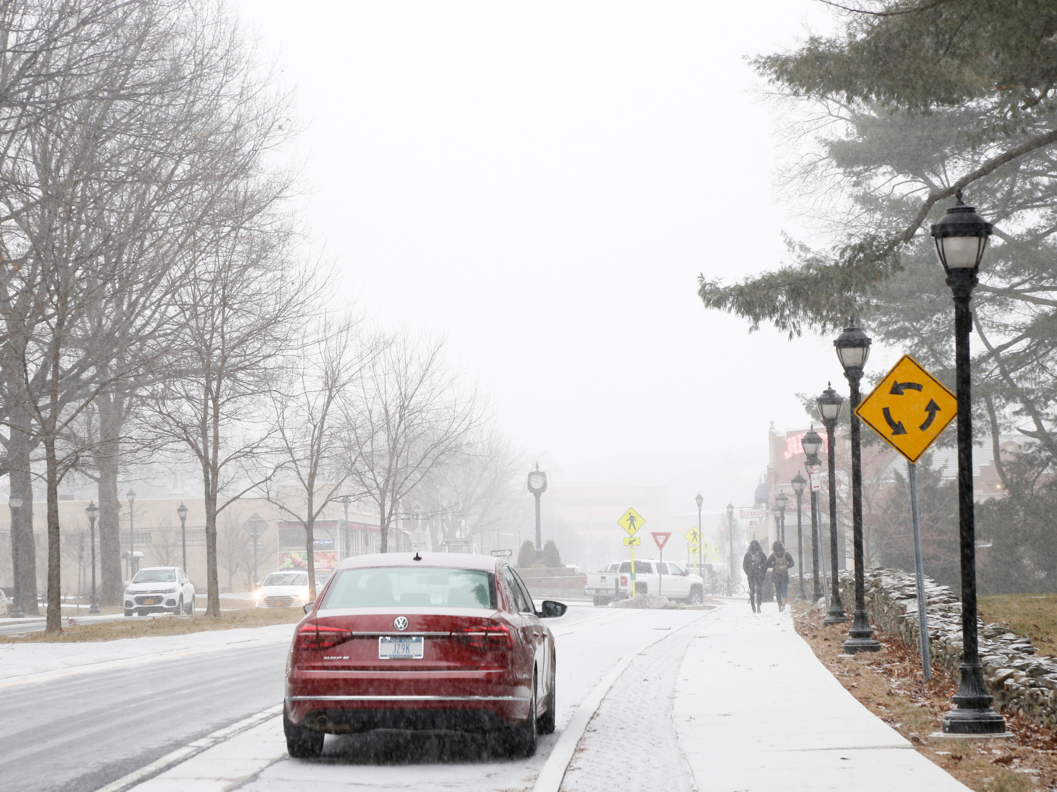 Snow falls as traffic moves along Raymond Avenue in the Town of Poughkeepsie on February 12, 2019.