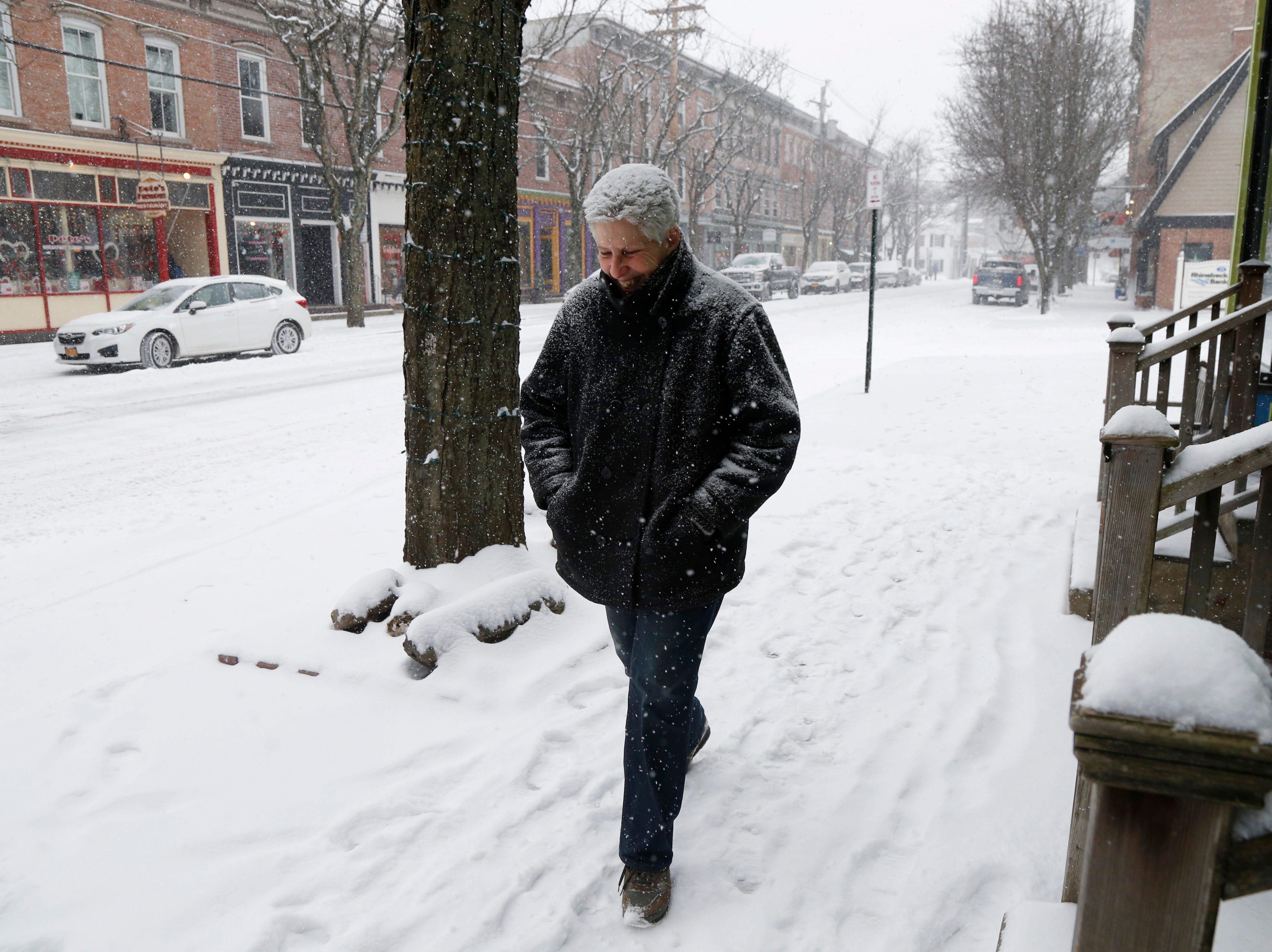 Sally Lyon walks along Market Street in Rhinebeck on February 12, 2019.