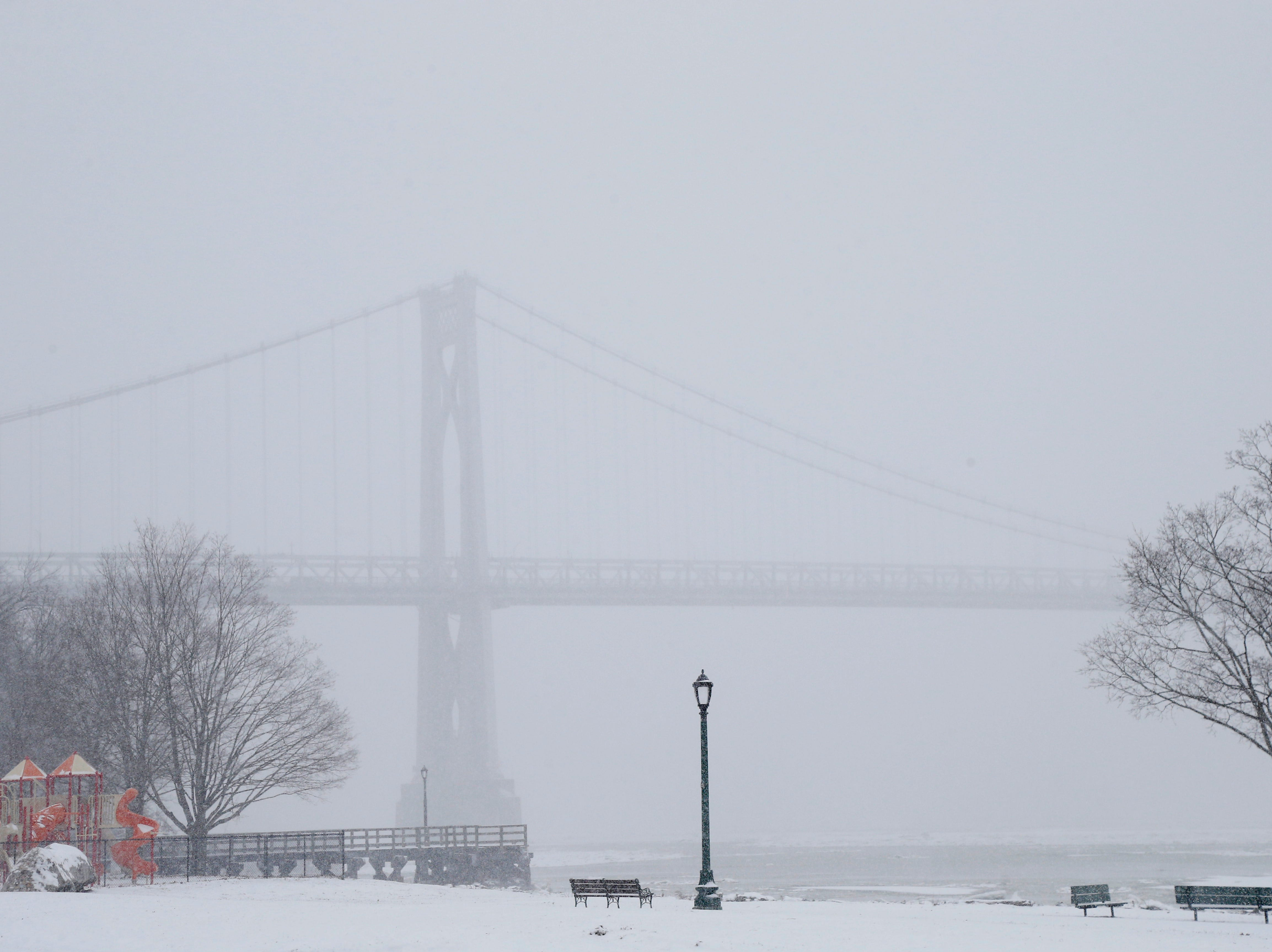 Snow obscures the view of the Mid-Hudson Bridge from Waryas park in the City of Poughkeepsie on February 12, 2019.