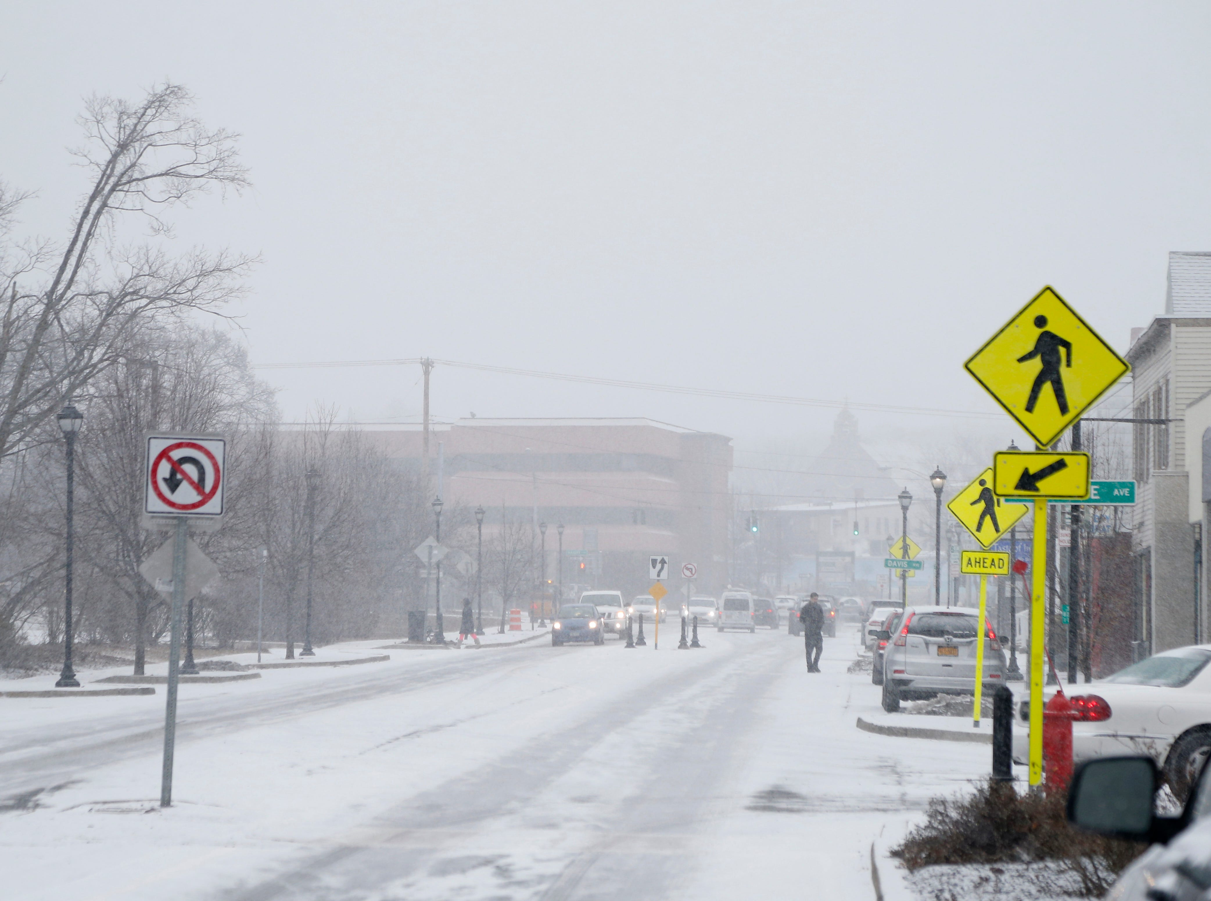 Snow falls along Raymond Avenue the Arlington Business District of the Town of Poughkeepsie on February 12, 2019.