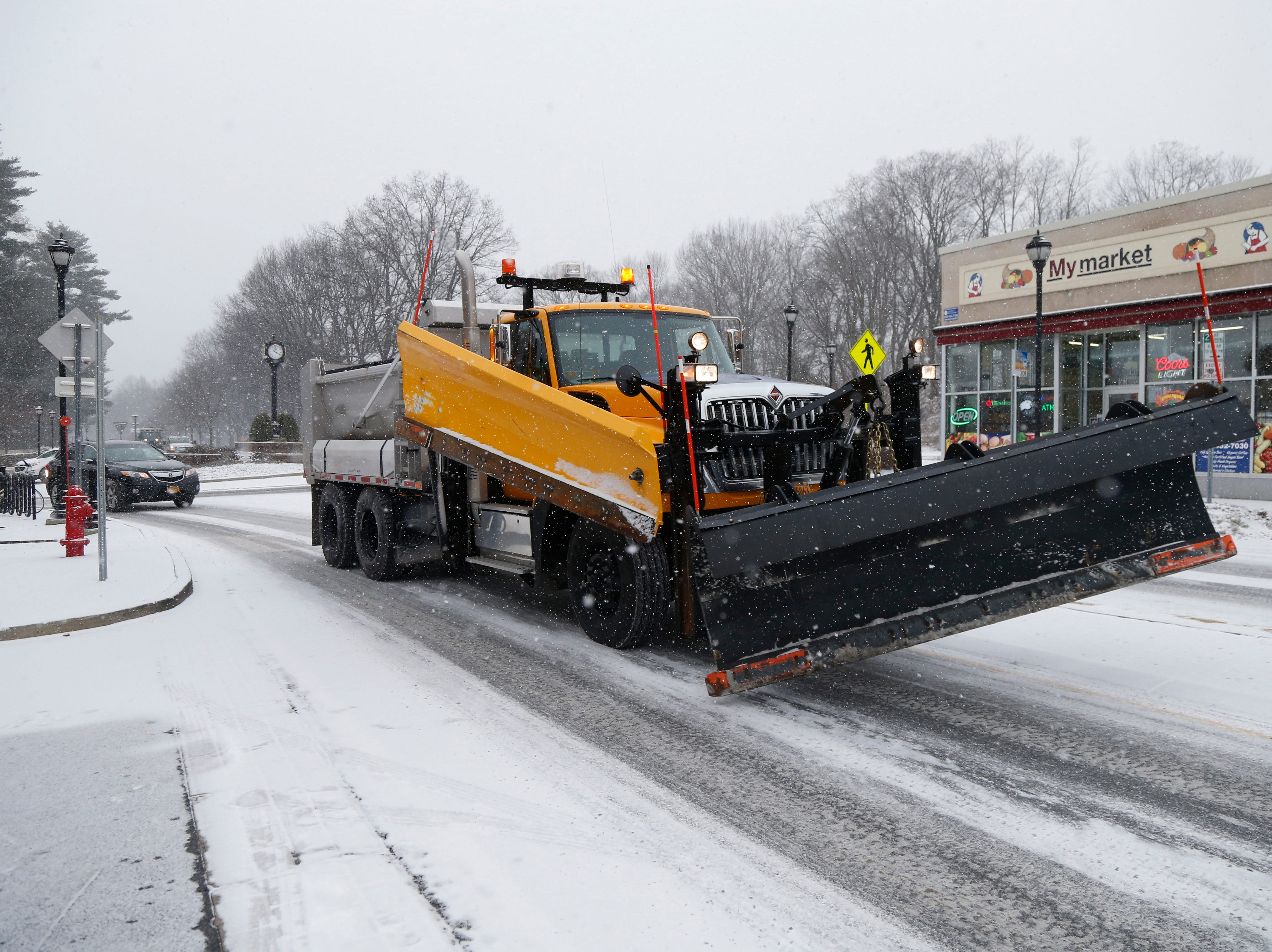 A Town of Poughkeepsie plow spreads salt on Raymond Avenue in the Arlington Business District of the Town of Poughkeepsie on February 12, 2019.