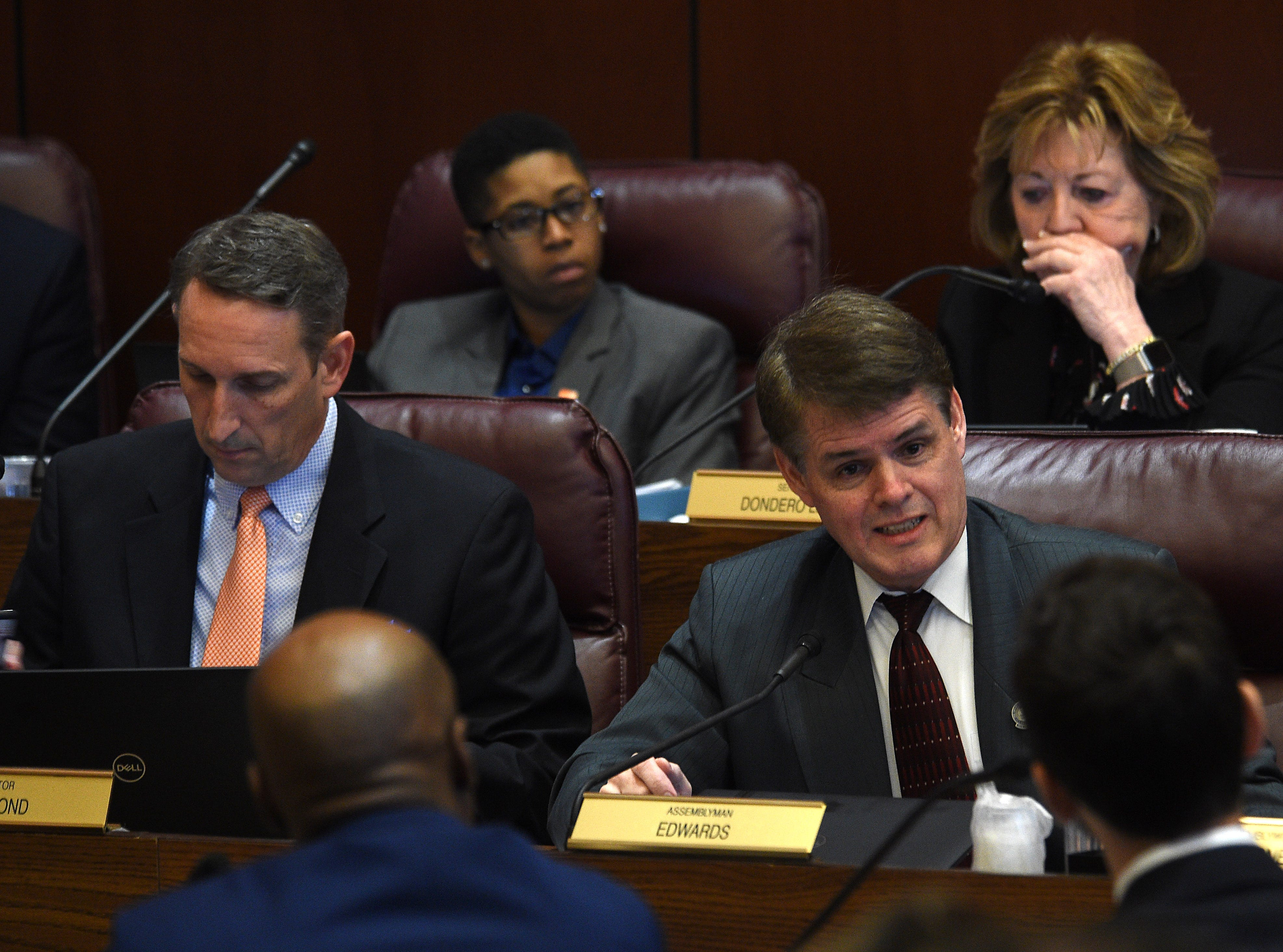 Assemblyman Chris Edwards (Rep.- District 19) asks a question to State Senate Majority Leader Kelvin Atkinson and William Rosen with Everytown for Gun Safety during a hearing for Senate Bill 143 at the Nevada Legislature Building in Carson City on Feb. 12, 2019.