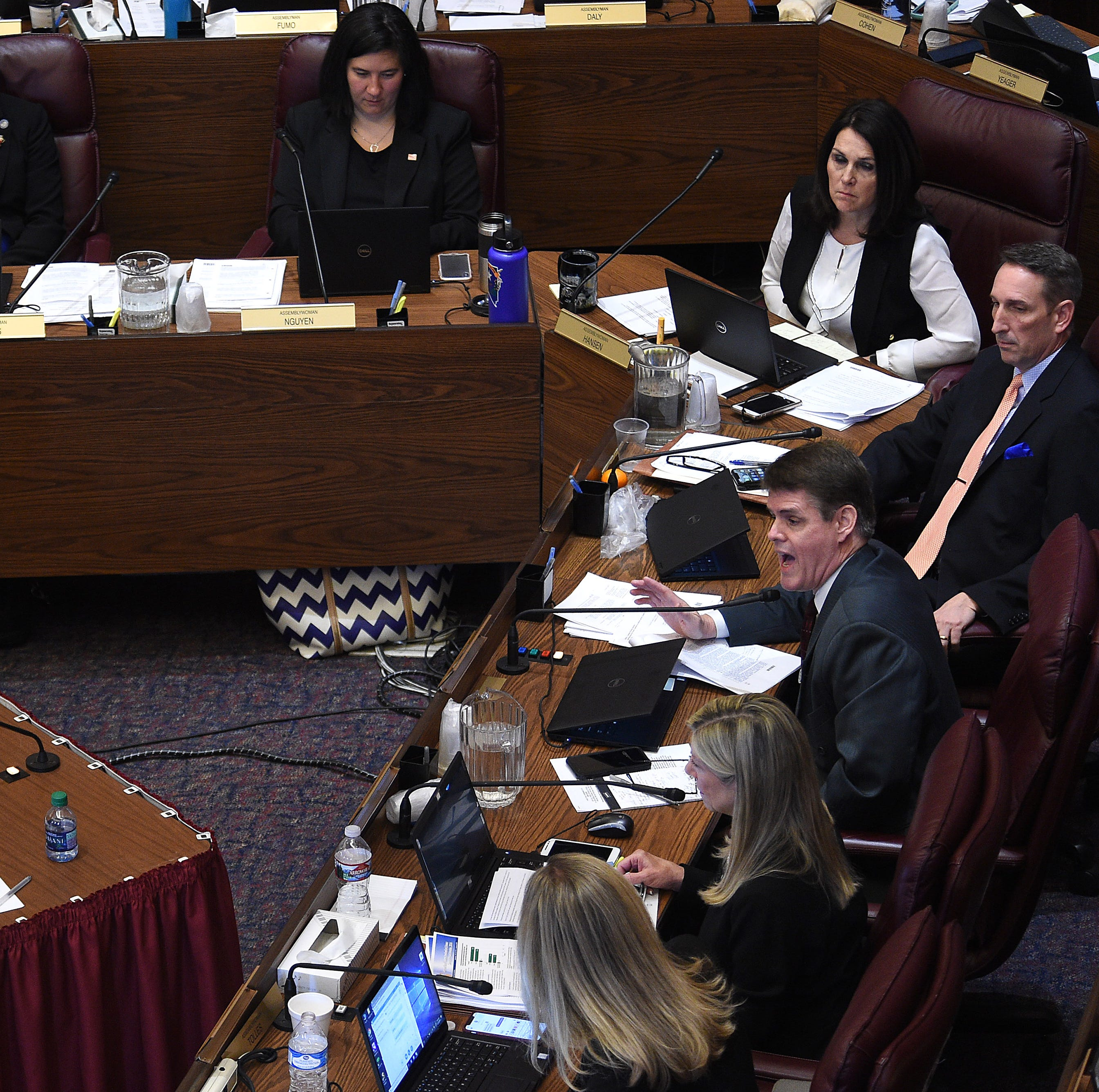 Assemblyman Chris Edwards (Rep.- District 19), right, asks a question to State Senate Majority Leader Kelvin Atkinson and William Rosen with Everytown for Gun Safety during a hearing for Senate Bill 143 at the Nevada Legislature Building in Carson City on Feb. 12, 2019.
