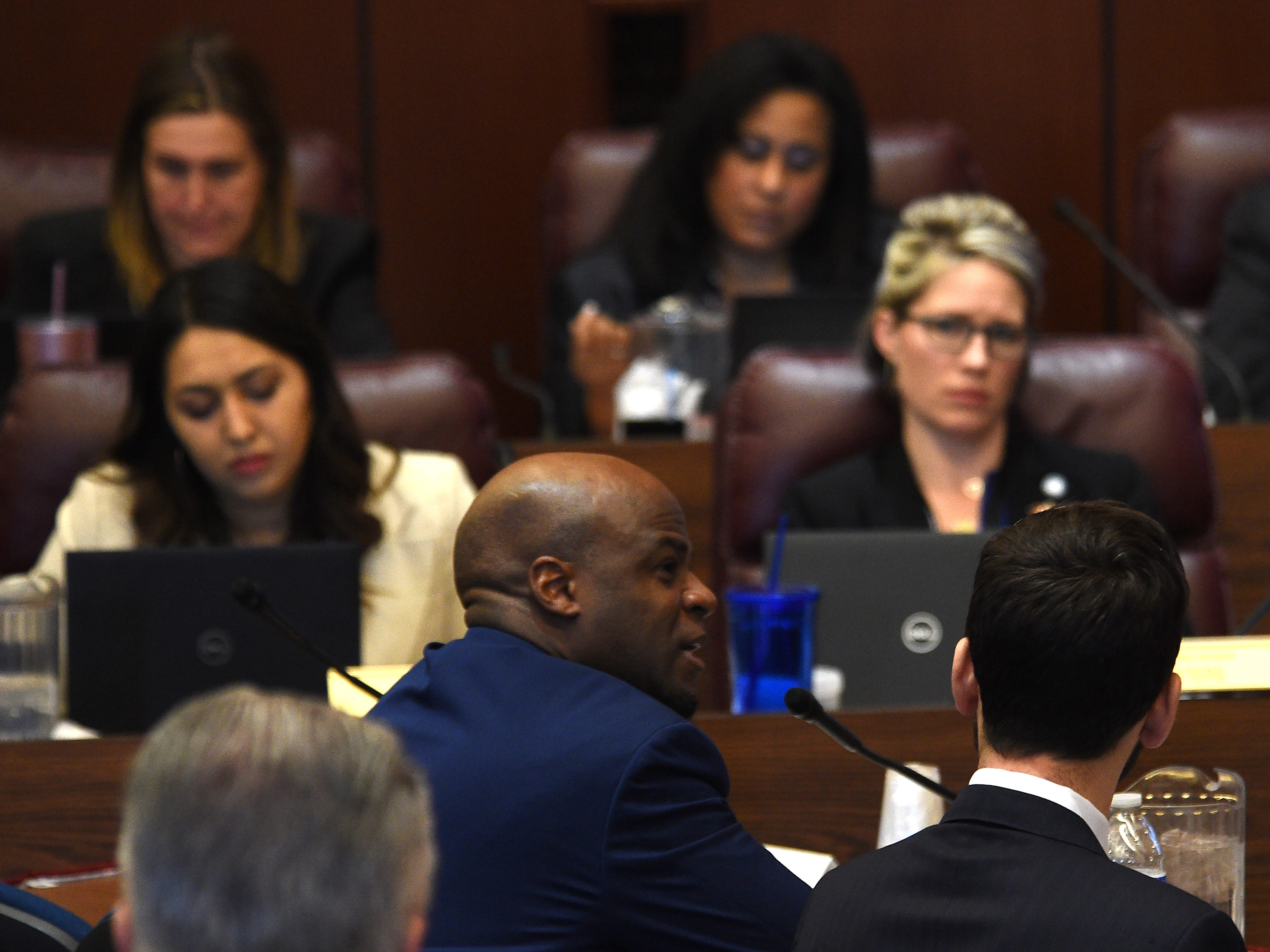 State Senate Majority Leader Kelvin Atkinson, middle, testifies during a hearing for Senate Bill 143 at the Nevada Legislature Building in Carson City on Feb. 12, 2019.