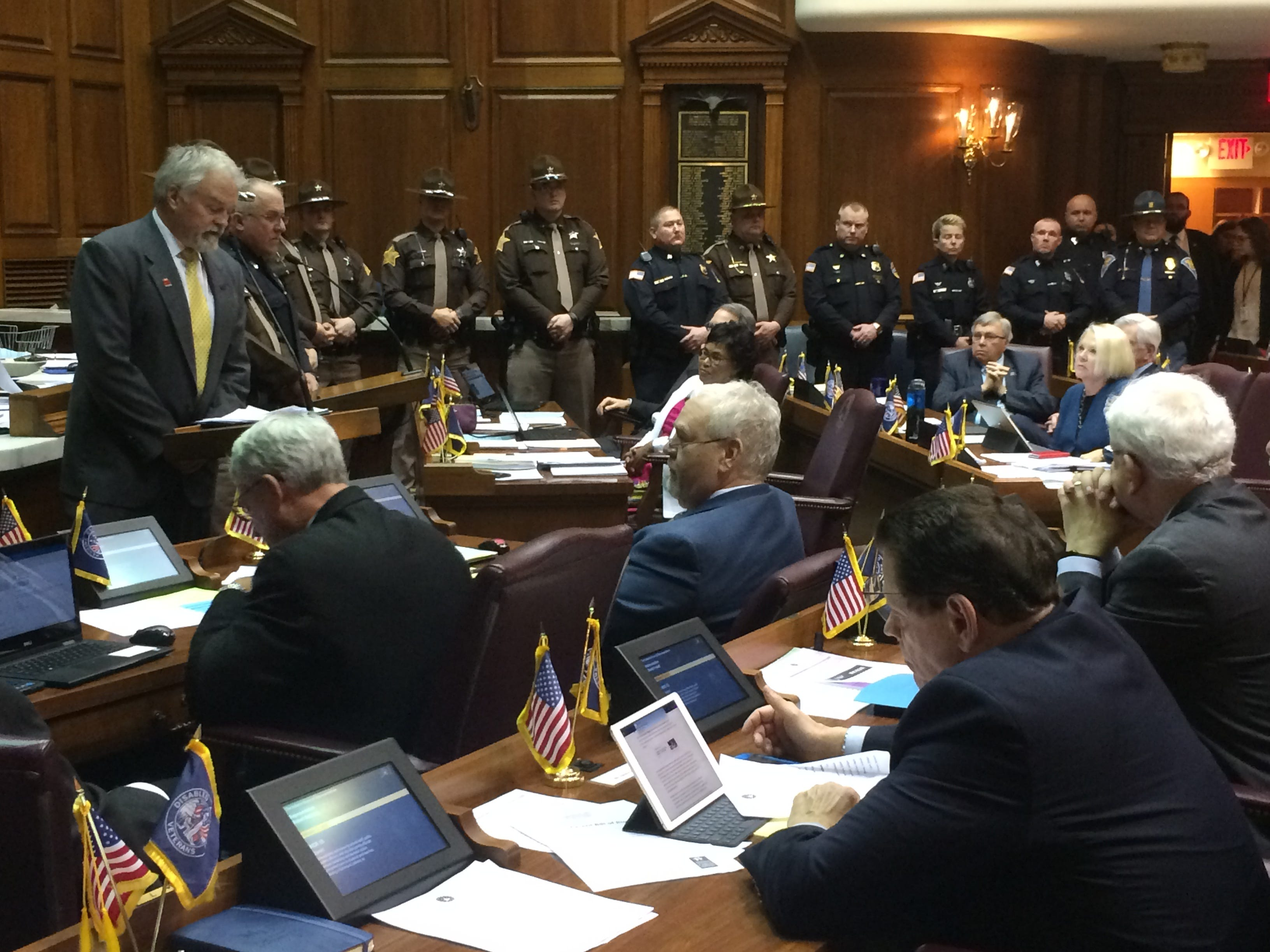 Richmond and Wayne County law enforcement officers stand before the House as Rep. Brad Barrett addresses House members Tuesday.