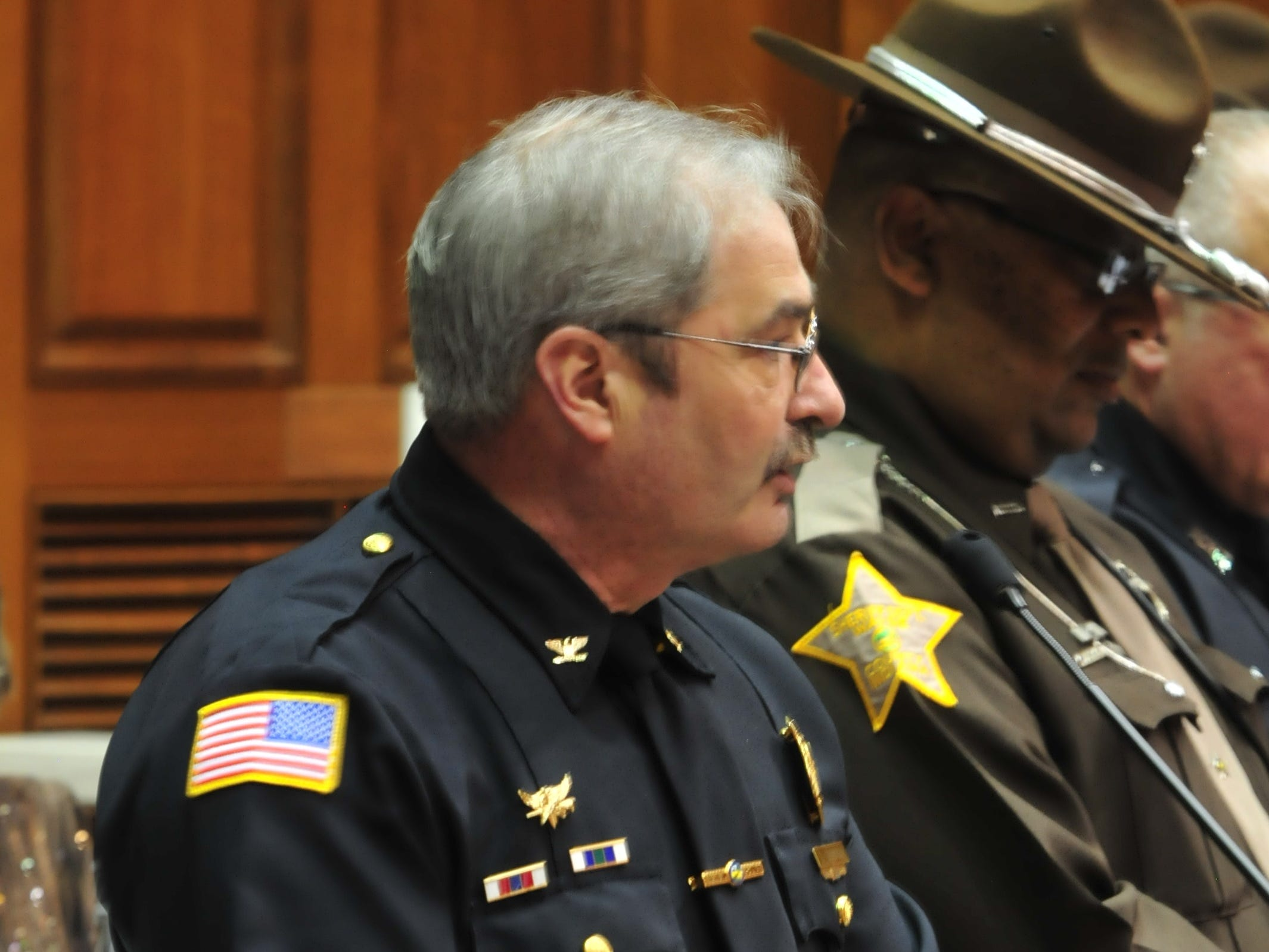 Chief Jim Branum speaks in the Indiana House on Tuesday after the reading of a resolution honoring school and law enforcement personnel for their actions Dec. 13 at Dennis Intermediate School.
