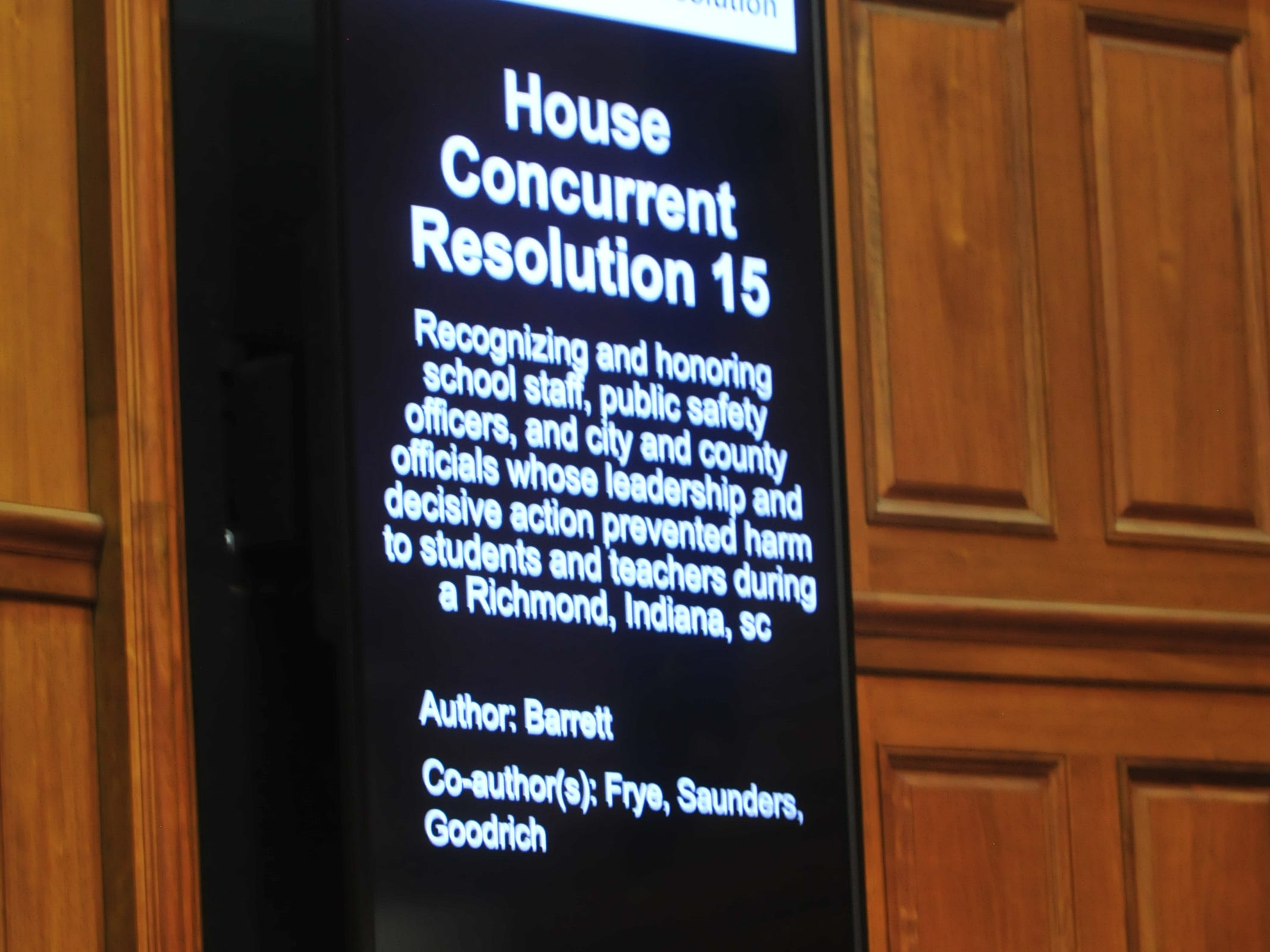 A board inside the House chambers announces the joint resolution honoring school and law enforcement officials for their actions Dec. 13 at Dennis Intermediate School.