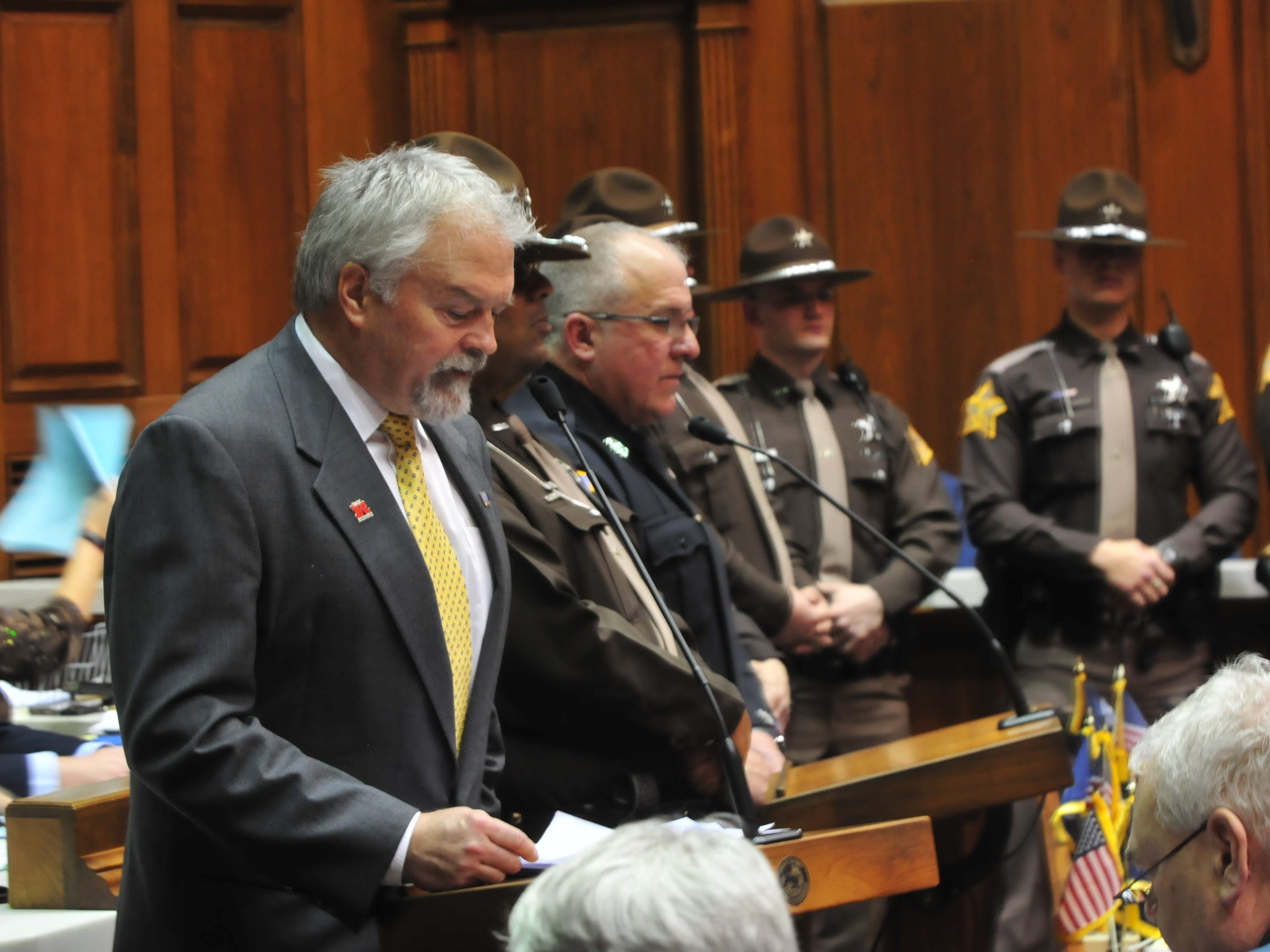 Rep. Brad Barrett addresses the House as Richmond and Wayne County law enforcement officers stand with him Tuesday.