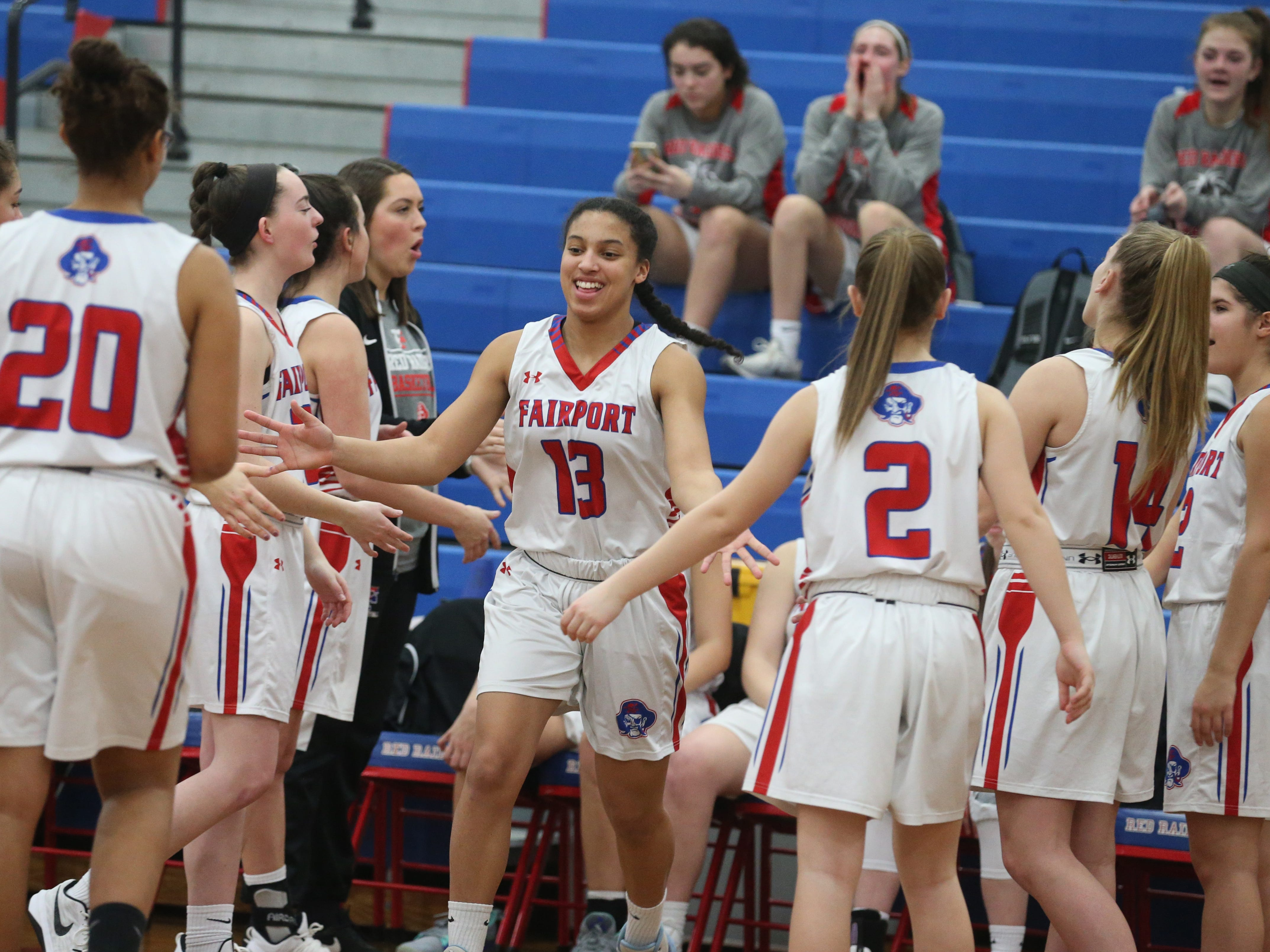 Fairport guard Ella Meabon gets high-fives from teammates as she is introduced with the starters.