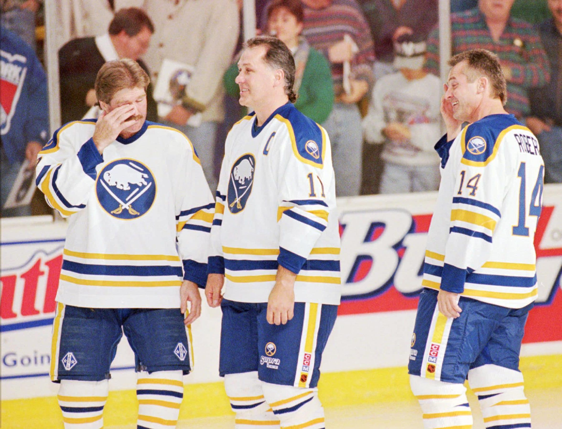 """Retired Buffalo Sabres linemates Richard Martin, left, Gilbert Perreault, center, and Rene Robert, known in the 1970s as the """"French Connection,"""" become emotional as their jerseys are raised together Wednesday, Nov. 15, 1995, at the Memorial Auditorium in Buffalo, N.Y. Martin and Robert joined previously inducted Perreault in the Sabres Hall of Fame before the Sabres game against the Dallas Stars. Former Rochester Americans coach Joe Crozier helped to put the French Connection together in the early 1970s."""
