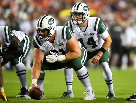 FILE - In this Aug. 16, 2018, file photo, New York Jets quarterback Sam Darnold (14) stands behind center Spencer Long (61) during the first half of a preseason NFL football game against the Washington Redskins in Landover, Md.