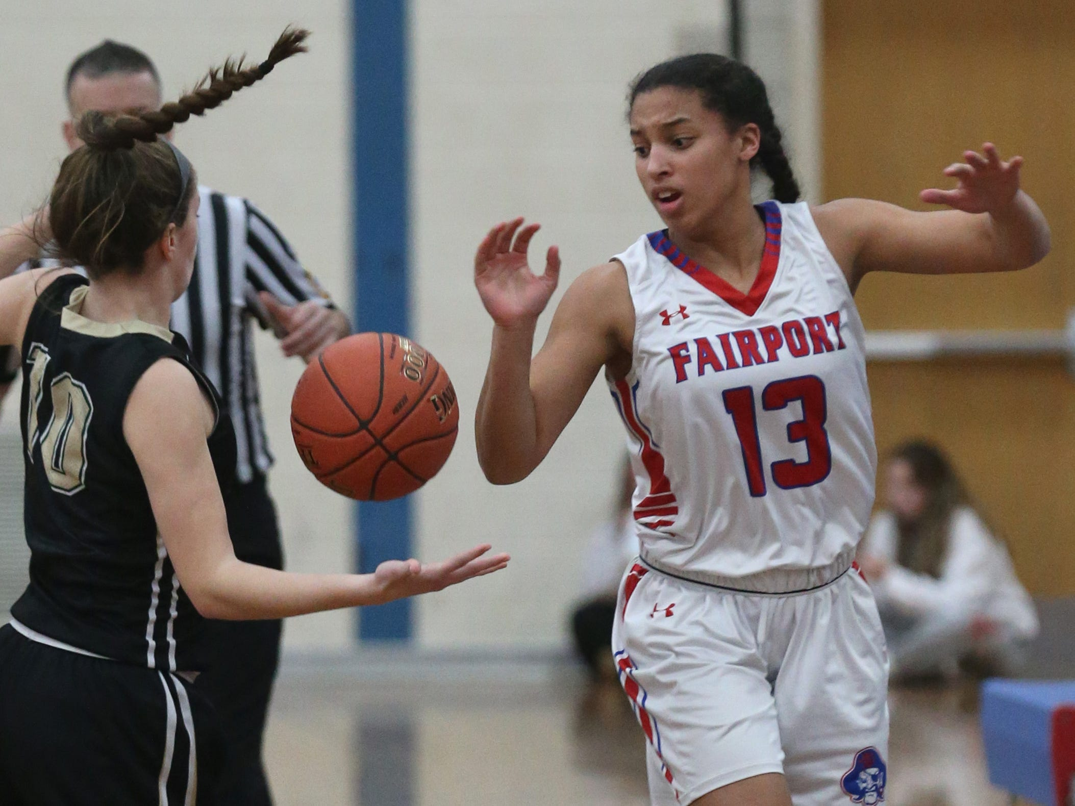 Fairport's Ella Meabon, right, knocks the ball away from Rush-Henrietta's Rachel Crane, left, at half court.
