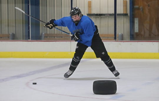 Blake Humphrey, a junior at Penfield High, works through individual skating drills at Evolve Hockey at the the Village Sports rink in Perinton Tuesday, Feb. 12, 2019.