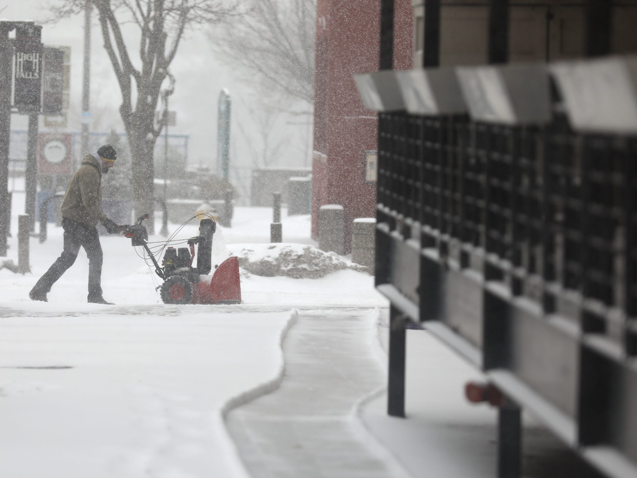 Snow came down quickly Tuesday morning making the day's commute slow with the slippery. roads.  Two snow blowers were used to clear the sidewalk around the building on Platt and Mill Sts.