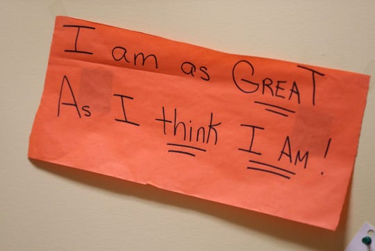 One of the signs that hang in the Help Zone at Wilson Magnet High School.