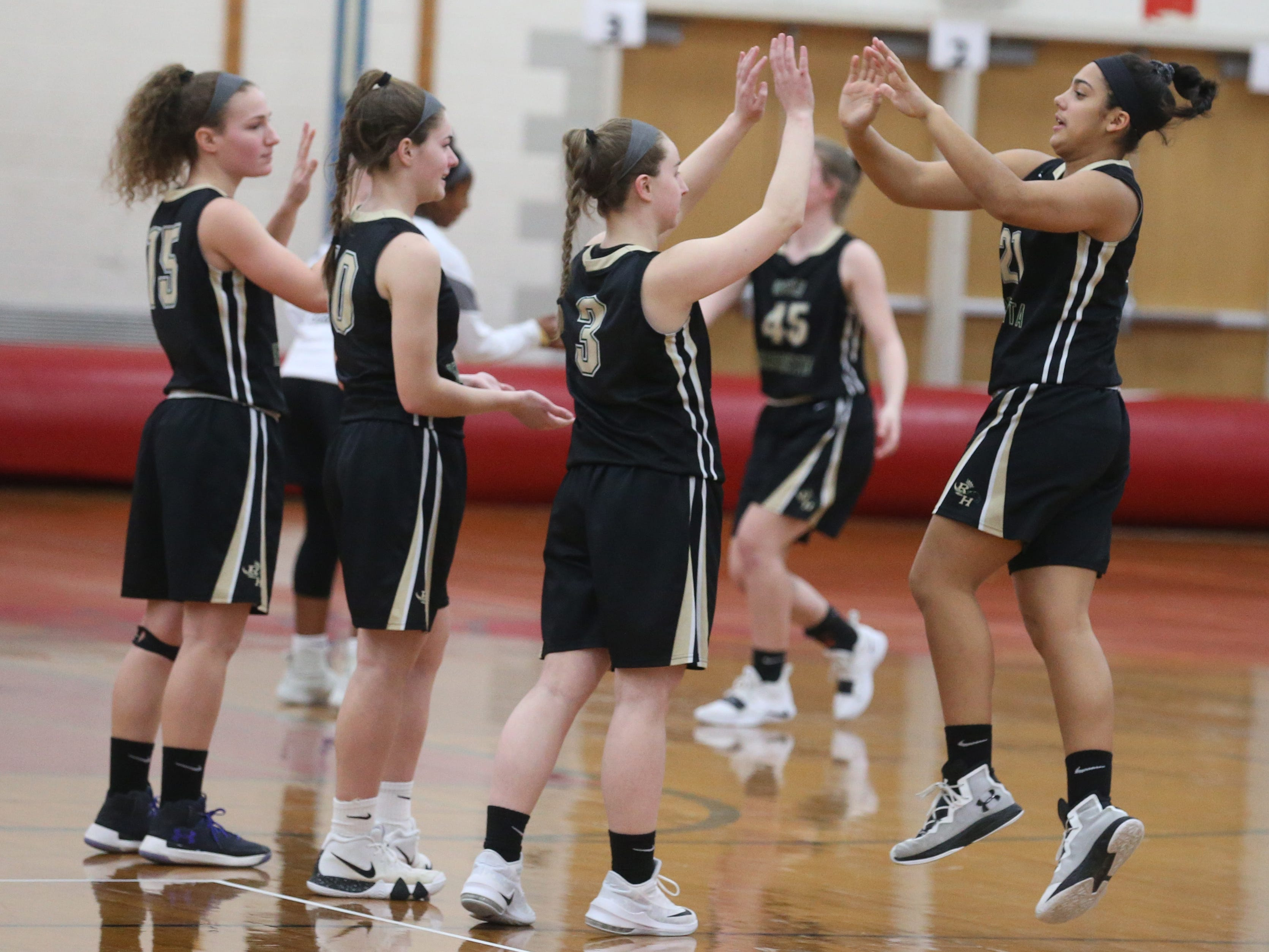 Rush-Henrietta's Gabby Garrett, right, gives a high five to teammate Logan Taylor as she is introduced with the starters.
