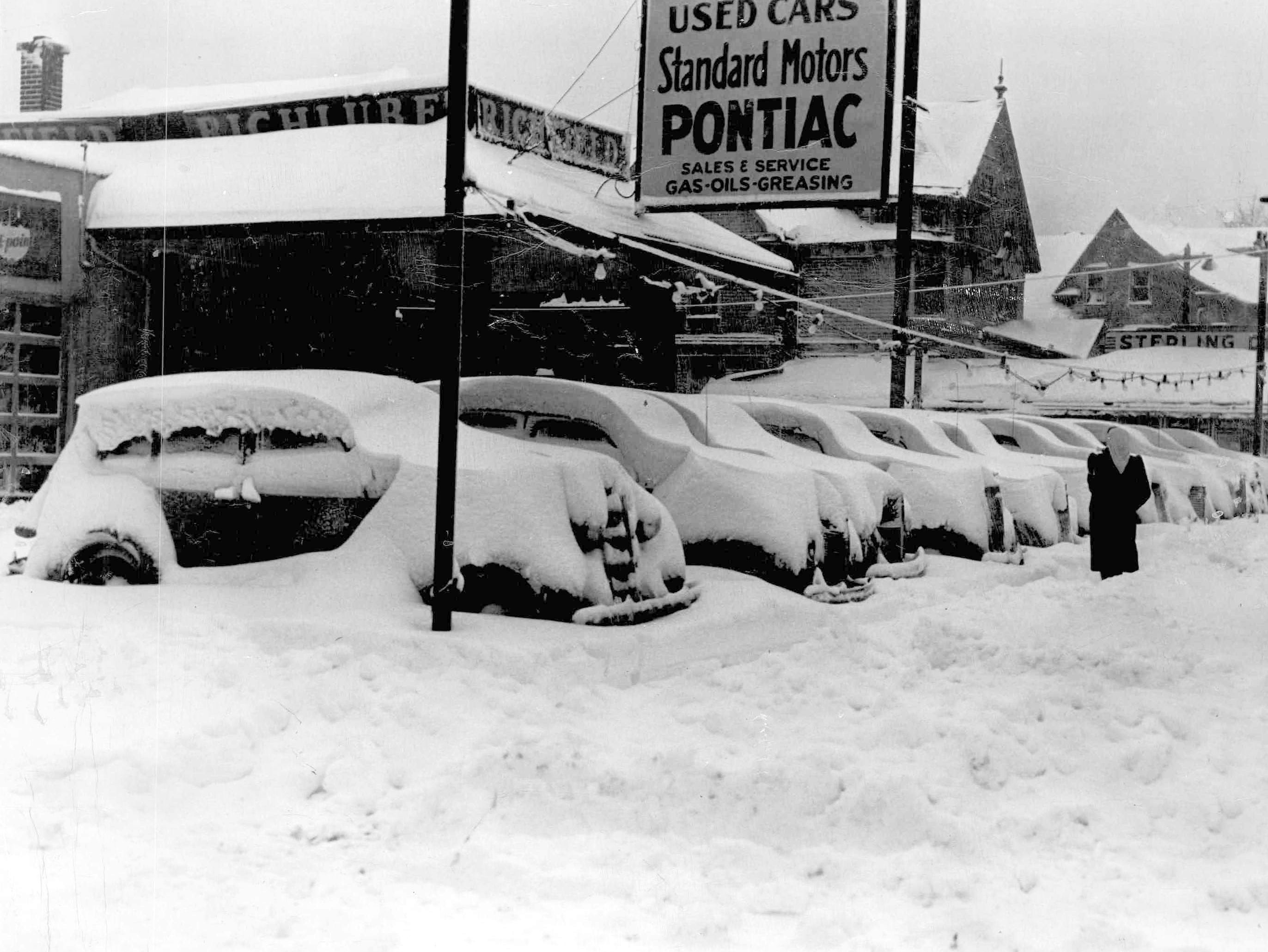 This photo from 1944 shows cars in a sales lot covered with snow following a storm.