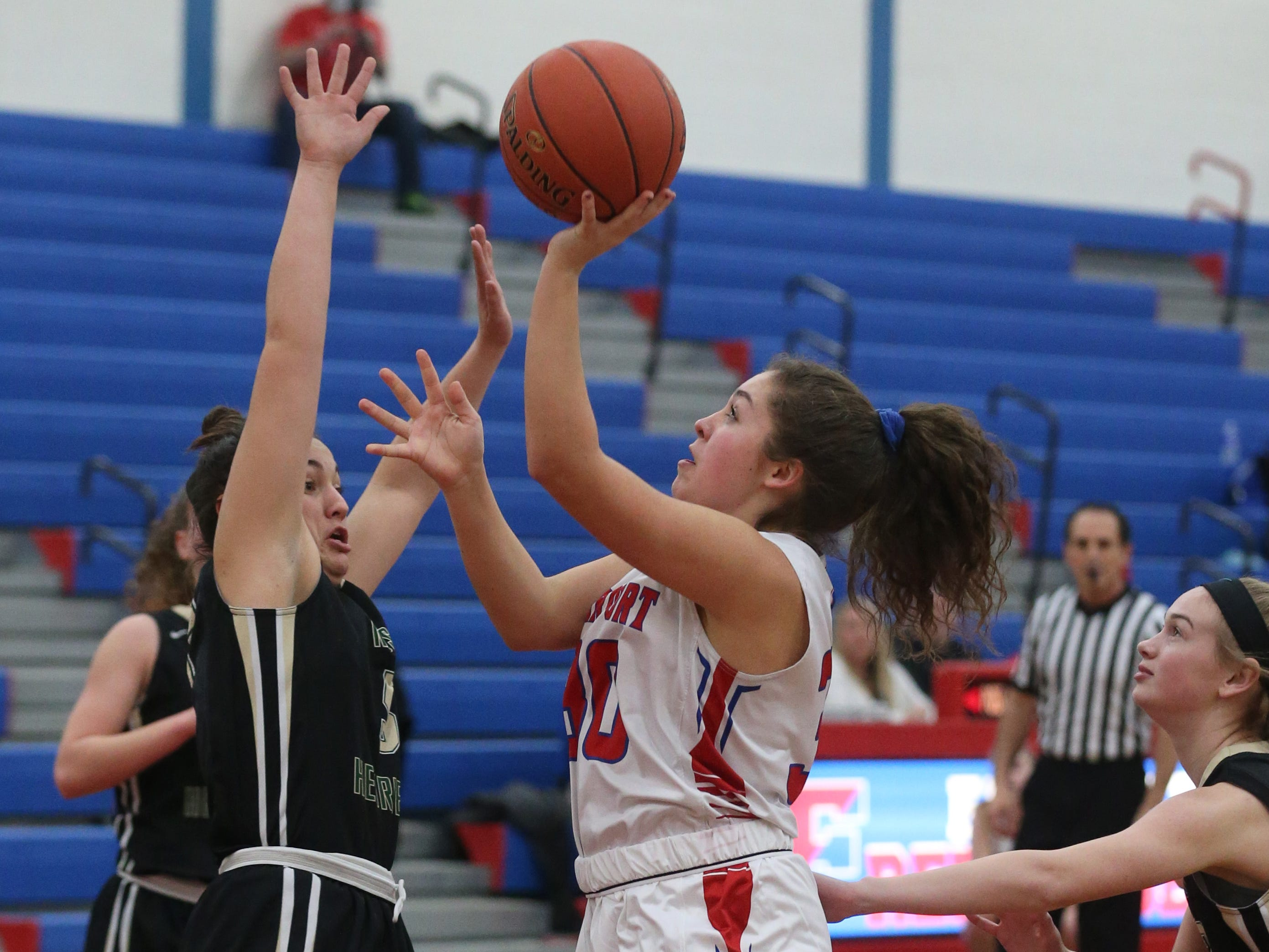 Fairport's Bryn Holmes, right, puts in two over Rush-Henrietta's Kaila Herring, left.