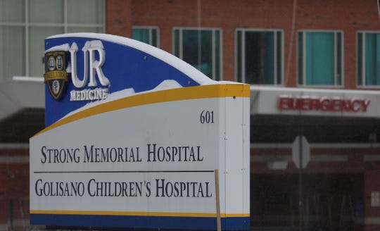 Sign for UR Medicine, Strong Memorial Hospital and Golisano Children's Hospital with the Emergency department behind it on Feb. 12, 2019.