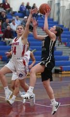 Rush-Henrietta's Rachel Crane, right, drives to the basket as Fairport's Grace Burnard defends.