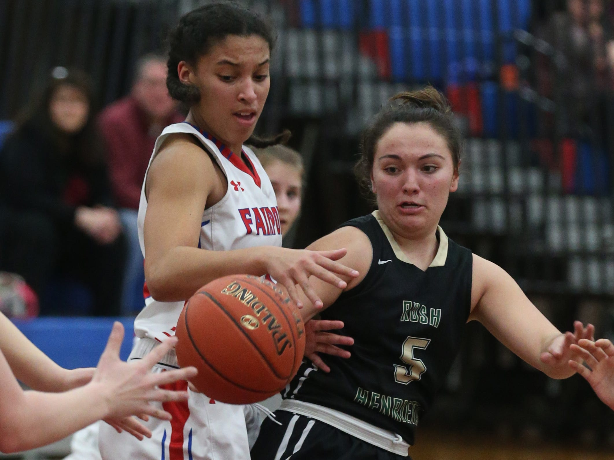 Rush-Henrietta's Kaila Herring, right, and Fairport's Ella Meabon, left, scramble for a loose ball.