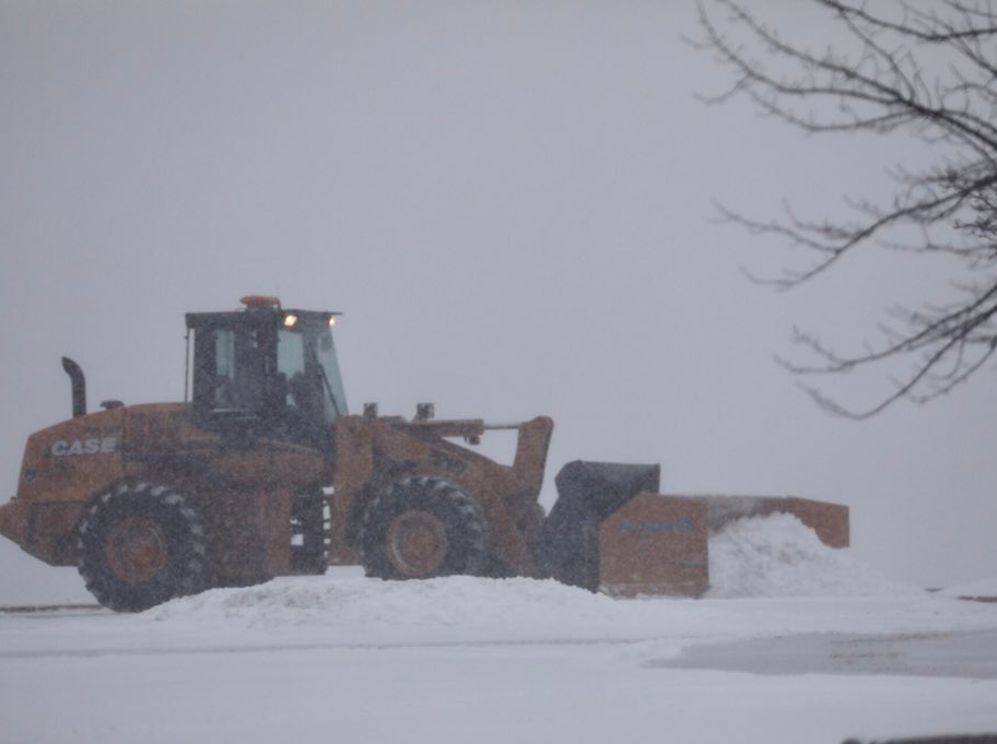 Plowing at Eastview Mall as the snow begins to mount Tuesday morning.