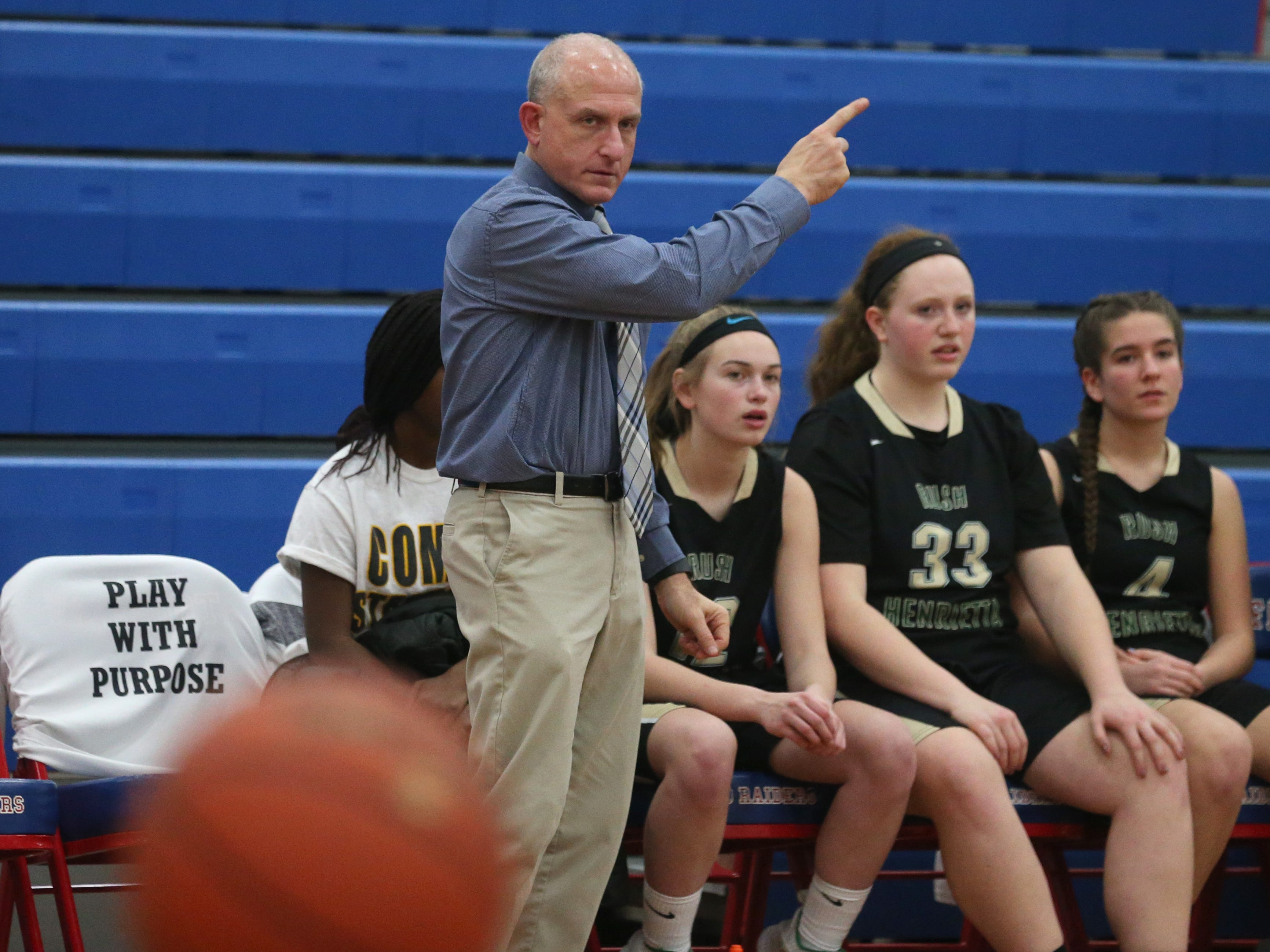 Rush-Henrietta head coach Alan Regan gives the officials a helping hand in the call of ball possesion.