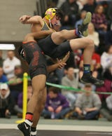 2019 weight class champions in action during the state qualifier, including Victor 132-pounder Alex Samson and Hilton 113-pounder Greg Diakomihalis