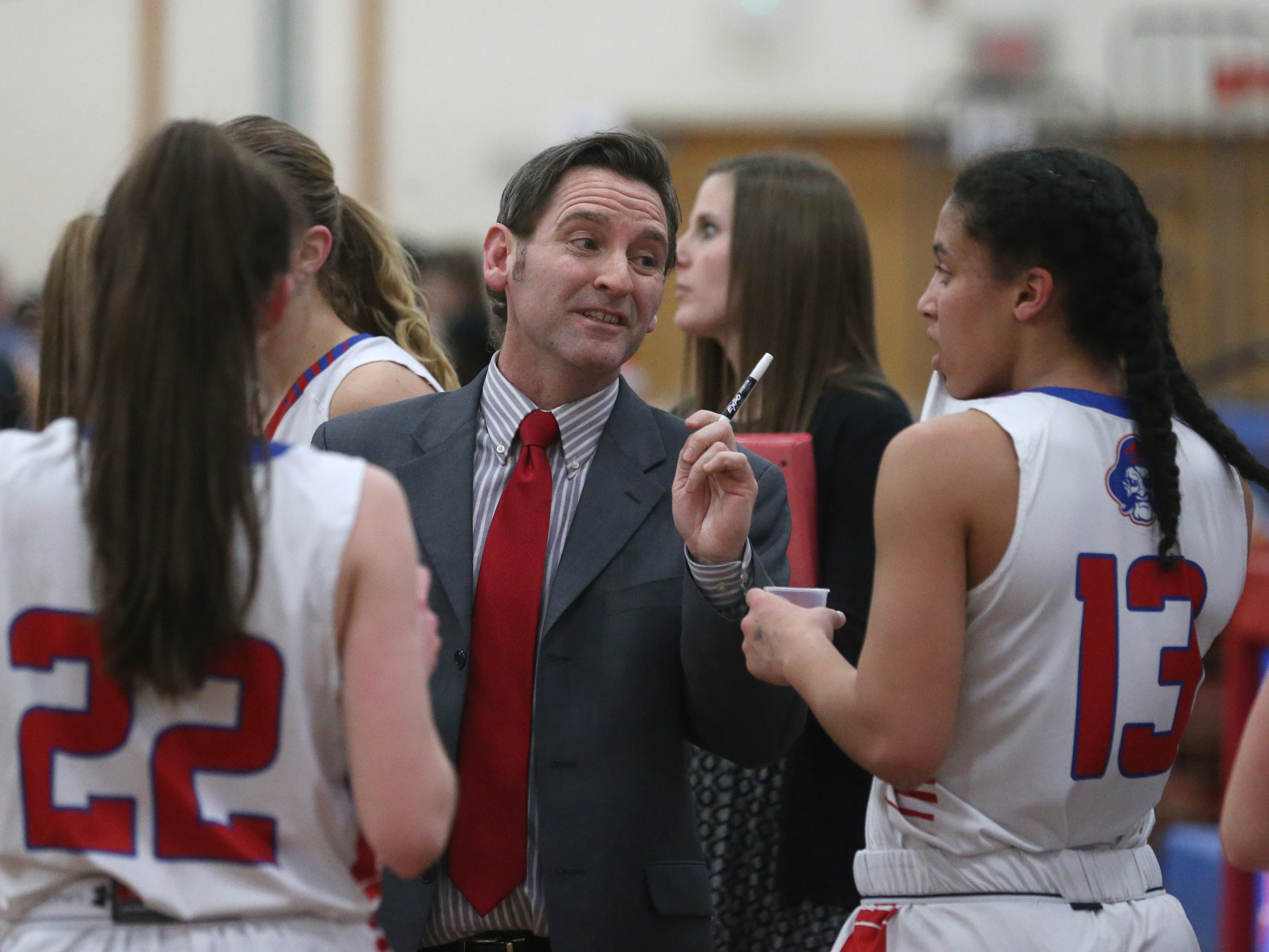 Fairport head coach Patrick Muldowney huddles his squad up during a 30-second timeout.