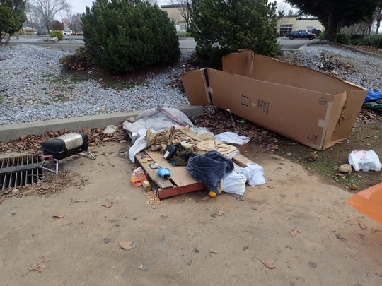 Among the areas the Redding Police Department's community cleanup team collected garbage Monday was around the former OfficeMax building on Churn Creek Road.