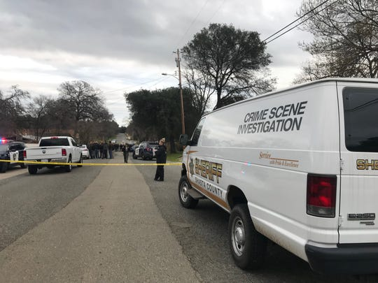 A crime scene van arrives on Arizona Street in south Redding after an officer-involved shooting on Monday, Feb. 11, 2019.