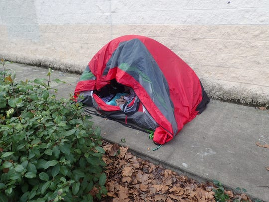 Police said this tent was found at the vacant OfficeMax building on Churn Creek Road.