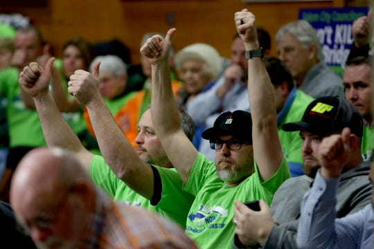 People show their support for a testimony given during a Salem City Council meeting on Monday, Feb. 11, 2019. The council is expected to make a final decision Monday over whether to build the third bridge over the Willamette River.