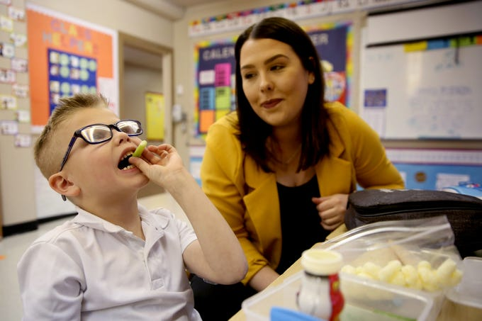 Kolton Wangler, 6, who has Type 1 diabetes, eats his lunch as his mom, Jessica Wangler, monitors his insulin dosage in his kindergarten classroom at St. Joseph Catholic School in Salem on Tuesday, Feb. 12, 2019. Wangler works in Sen. Peter Courtney's office, and when he heard her story he introduced a bill to allow people to get emergency insulin from the pharmacy.