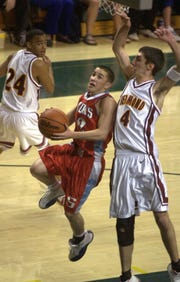 South Salem's Jeremiah Dominguez drives to the basket during the Class 4A boys state basketball championship game March 13, 2004 in Eugene.