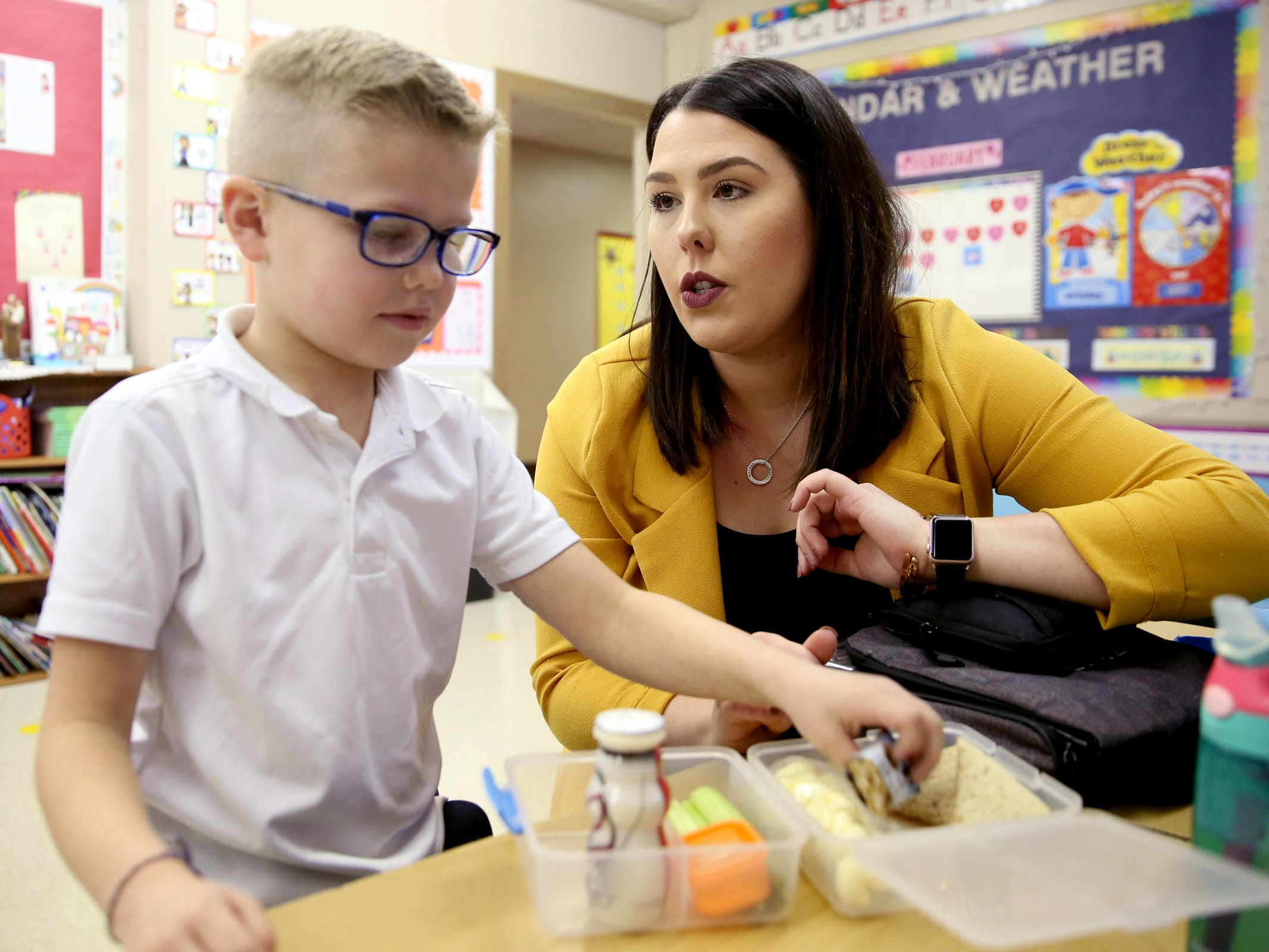 Jessica Wangler monitors the insulin dosage for her son Kolton Wangler, 6, who has Type 1 diabetes during his lunch break in his kindergarten classroom at St. Joseph Catholic School in Salem on Tuesday, Feb. 12, 2019. Wangler works in Sen. Peter Courtney's office, and when he heard her story he introduced a bill to allow people to get emergency insulin from the pharmacy.