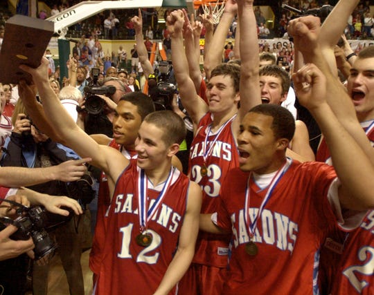 South Salem's Jeremiah Dominguez (12) joins his teammates in celebrating their 54-43 win over Redmond in the Class 4A boys' championship game March 13, 2004, in Eugene.