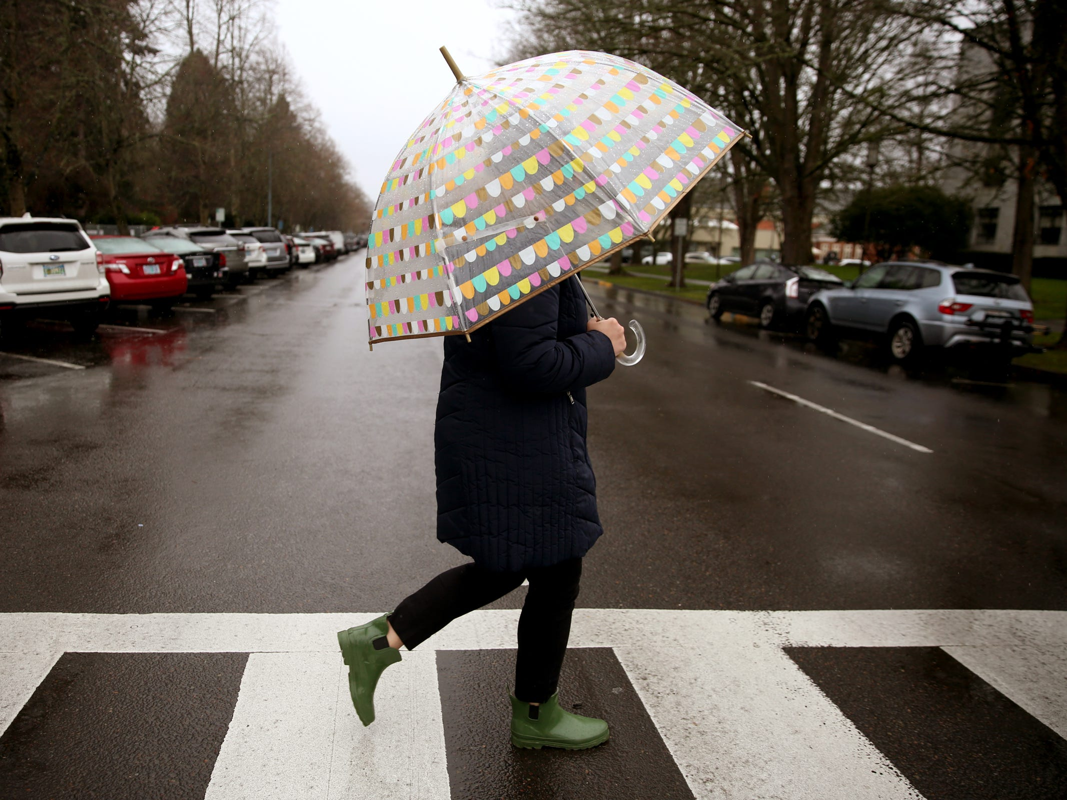 Jessica Wangler walks from the Oregon State Capitol to her son's school, St. Joseph Catholic School, so she can monitor his insulin dosage during his lunch break in Salem on Tuesday, Feb. 12, 2019. Wangler works in Sen. Peter Courtney's office, and when he heard her story he introduced a bill to allow people to get emergency insulin from the pharmacy.